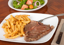 T-bone Steak Dinner stock images