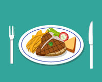 T-bone steak and french fries on dish Stock Images
