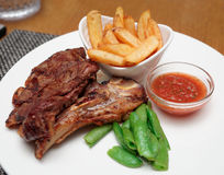 T-bone steak with french fries Stock Images