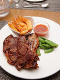 T-bone steak with french fries Royalty Free Stock Photography