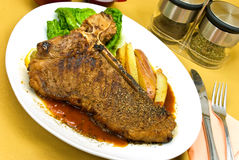 T - Bone Steak with fresh Salad and red Potatoes Stock Image