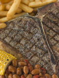 T-Bone Steak with Fries Corn and Beans Stock Photography