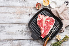 T-bone Steak on frying grill pan stock photos