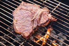 T-Bone Steak on a Grill Stock Photo
