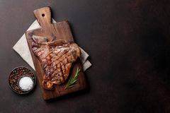 T-bone steak. Grilled T-bone steak on stone table. Top view with copy space Stock Photos