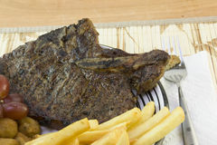 T-bone steak meal Royalty Free Stock Image