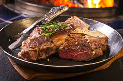 T-Bone Steak in a Pan Stock Photography
