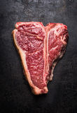 T-bone steak on rust metal background, top view Royalty Free Stock Photography