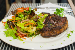 T-bone steak with salad. Royalty Free Stock Images