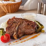 T- Bone Steak. With mushroom and pepper sauce royalty free stock photography