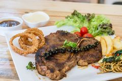 T-bone steak. Served with onion ring , french fried and salad Royalty Free Stock Images