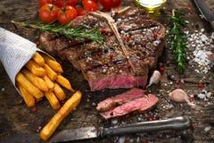 T-Bone Steak. On wooden background stock photo