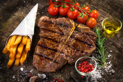 T-Bone Steak. On wooden background Stock Photography