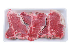 T-Bone Steaks in Foam Tray Stock Images