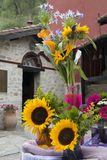 T bouquet of gerbera and sunflowers on old  church  background Royalty Free Stock Photos