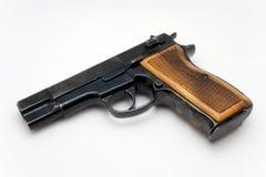 tła chwyta pistoletu biel drewno Obraz Royalty Free