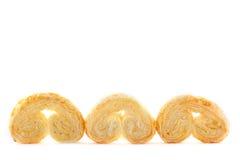 tła ciastek trzy biel Fotografia Stock