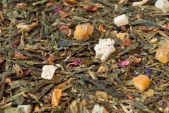 Tè con le parti di frutta Fotografia Stock