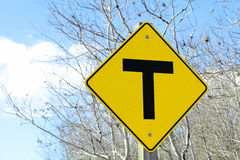 T crossing road sign along a country road.  Stock Photography