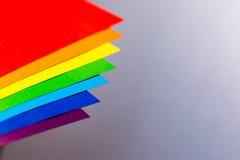 Tęcza kolory z papierami Obraz Stock