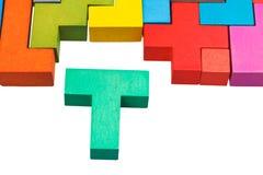 T-förmiger Block und hölzernes Puzzlespiel Stockbilder