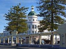 T&G Building Art Deco Napier New Zealand & Pine Trees Stock Photo
