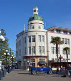 T&G Building Art Deco Napier New Zealand & Vintage Car. Napier - New Zeland - April 27, 2017: The T&G Building Is an example of the Art Deco style of Stock Photos