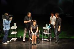 T.Hartley makes hairstyle for Natasha Koroleva Stock Photo
