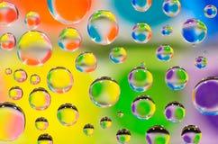 tła kolorowa kropelek woda Fotografia Stock