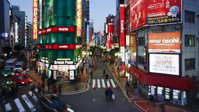 T l wide shot traffic and pedestrians on musashino street in shinjuku tokyo stock footage