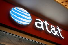 At&t Logo sign on wall above store in Ala Moana Mall. Honolulu - November 26, 2015: at&t Logo sign on wall above store in Ala Moana Mall. AT&T Mobility LLC, also stock photo