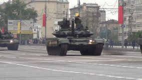 T-90A main battle tanks move in motorcade on Tverskaya Zastava square during night rehearsal of parade