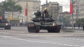 T-90A main battle tanks move in motorcade on Tverskaya Zastava square during night rehearsal of parade. Moscow, Russia - May 5: T-90A main battle tanks move in
