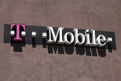 T-Mobile cellular retail store front sign. Lighted sign above T-Mobile retail store. T-Mobile is a leading cellular phone carrier in the United States stock photography
