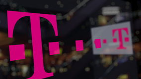T-Mobile logo on the glass against blurred business center. Editorial 3D rendering Stock Photos