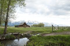 T A Moulton Barn in Grand Tetons National Park. T A Moulton famous wood barn in Grand Tetons National Park Mormon Row with snow capped mountains in background in Stock Images