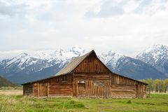 T A Moulton Barn in Grand Tetons National Park. T A Moulton famous wood barn in Grand Tetons National Park Mormon Row with snow capped mountains in background in Royalty Free Stock Photo