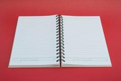 tła notatnika czerwieni spirala Zdjęcia Royalty Free