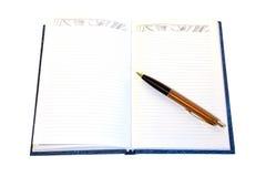 tła notatnika pióra biel Zdjęcie Stock