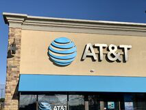 The AT&T office sign at the shop store. AT&T Mobility Wireless Retail Store. AT&T now offers IPTV, VoIP, Cell Phones and DirecTV