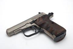 tła pistoletu srebra biel Obrazy Stock