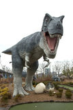 T-Rex with baby in eggs. NIAGARA FALLS, CANADA-JANUARY 11, 2016:  Replica of a T-Rex dinosaur with baby in eggs in a mini putt at Niagara falls in Ontario Royalty Free Stock Image