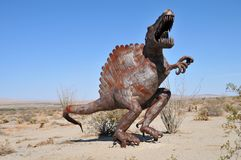T-Rex Dinosaur Metal Sculpture at Anza Borrego Desert California. Dinosaur metal sculptures in the Anza Borrego Desert. Sculptures are public art displayed over stock image