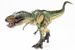 T-rex plastic figurine. On white background royalty free stock images