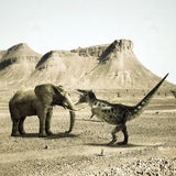 T-rex versus elephant. T-rex fighting versus a big elephant in the desert Royalty Free Stock Image