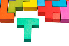 T-shaped block and wooden puzzle Stock Images