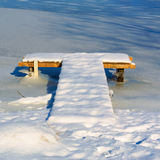 T-shaped wooden berth covered with snow Royalty Free Stock Image