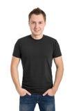 T-shirt cinzento em um homem novo Fotos de Stock