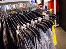 T-shirt in clothing store Stock Images