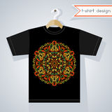 T-Shirt Design With Bright Symmetric Pattern. Black t-shirt with round symmetric ethnic pattern. Print design. Abstract ornament for stylish clothing Royalty Free Stock Image